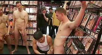 Gay dude gets undressed in a video shop